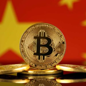 A standing bitcoin in front of the China flag