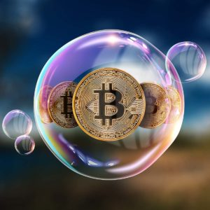 Picture of three bitcoins inside a bubble