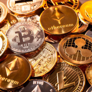 Picture of various crypto coins laying on top of each other