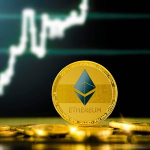 Picture of a gold Ethereum coin standing in front of an upward moving chart