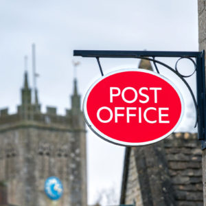 Picture of a red and white Post Office sign