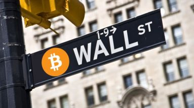 Picture of a Wall Street street sign with a bitcoin logo next to it