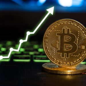 Picture of a bitcoin with an arrow pointing upwards next to it