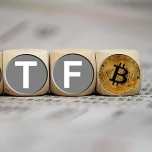 Picture of letter boxes with ETF written on them and a bitcoin at the end